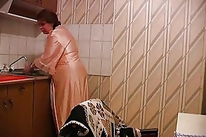 son bonks mother at the kitchen