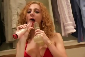 gal plays with fake penis