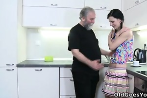 karina kneels previous to both of her fellows and