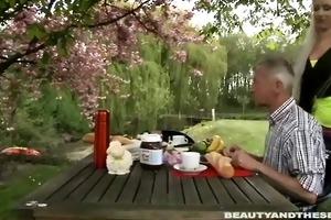paul is enjoying his breakfast in the garden with