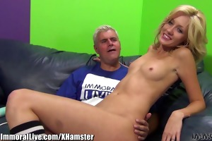 cute golden-haired stretches her lengthy legs for